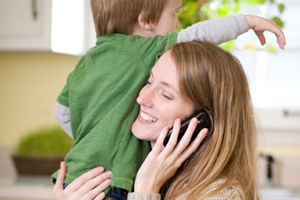 Busy woman with child and phone