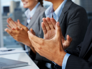 Closeup of business people applauding during a business meeting