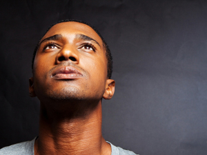 Man thinking, looking upward