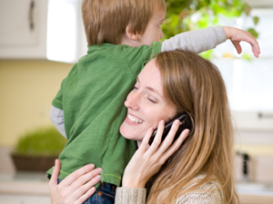 Mother on phone and child