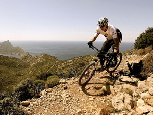 Man on a mountain bike on a rough track